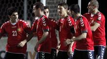 Armenia players celebrate a goal against Canada during their friendly match. (Petros Karadjias/Associated Press)