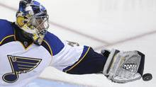 FILE - In this April 11, 2014, file photo, St. Louis Blues goalie Ryan Miller reaches for the puck during the third period of an NHL hockey game against the Dallas Stars in Dallas. (Associated Press)