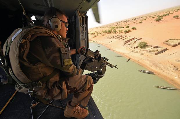 A French soldier patrols during a tactical flight on March 12 over Mali.