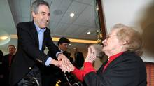 Liberal Leader Michael Ignatieff greets a senior during a campaign stop in Laval, Que., on Thursday morning, April 7, 2011 (Nathan Denette/The Canadian Press/Nathan Denette/The Canadian Press)