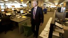 Postmedia Network Inc. CEO Paul Godfrey walks through the National Post newsroom in Toronto. (Darren Calabrese For The Globe and Mail)