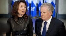 Deputy premier Nathalie Normandeau announces her resignation as Quebec Premier Jean Charest looks on September 6, 2011. (Jacques Boissinot/The Canadian Press)