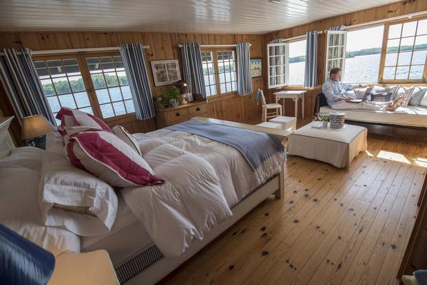John de Jong shows off his boat house cottage bedroom on Lake Joseph in Ontario.