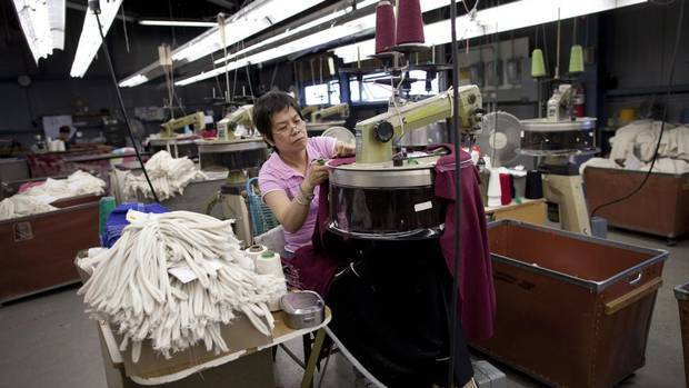 Employees work at the Parkhurst Knitwear factory in Toronto May 15, 2013. Parkhurst is one the last domestic knitting mills in Canada. (Moe Doiron/The Globe and Mail)