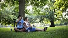 Darrell Harrylall, left, and Charley Nelson enjoy a beer in Trinity Bellwoods Park. Neighbours' complaints about late-night drinking have led to a police crackdown and differences of opinion. (Della Rollins)