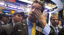 A trader wipes his eyes as he waits for the initial public offering of ClubCorp Holdings on the floor of the New York Stock Exchange September 20, 2013. (LUCAS JACKSON/REUTERS)