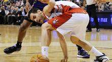 Toronto Raptors Jose Calderon loses the ball during the first half of an NBA basketball game in Toronto, February 25, 2011. (MARK BLINCH)
