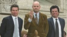 Tragically Hip lead singer Gordon Downie blows a kiss alongside bandmates Gord Sinclair (left) and Paul Langlois as they are recognized by the Speaker in the House of Commons on Parliament Hill in Ottawa, May 1, 2008. (Tom Hanson/Tom Hanson / Canadian Press)