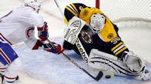 Boston Bruins goaltender Tim Thomas (R) makes a save against Montreal Canadiens left wing Travis Moen during the second period in Game 2 of their NHL Eastern Conference quarter-final hockey game in Boston, Massachusetts April 16, 2011. REUTERS/Brian Snyder (Brian Snyder/Reuters)