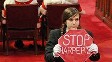 Senate page Brigette DePape stages an anti-Harper protest during the Speech from the Throne in Ottawa on June 3, 2011. (Sean Kilpatrick/THE CANADIAN PRESS)