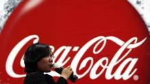 A visitor drinks a bottle of Coca-Cola during a media tour at PT Coca-Cola Amatil Indonesia's factory in Cibitung, Indonesia's West Java province in this Feb. 24, 2011 file photograph. (BEAWIHARTA/REUTERS)