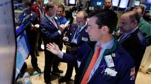 Traders gather at the post of specialist John McNierney, foreground, on the floor of the New York Stock Exchange Tuesday, Feb. 4, 2014. (Richard Drew/AP)
