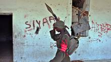 A soldier from the newly formed anti crime squad, armed with a rocket launcher, conducts a search for illegal weapons on September 5, 2009 in Mogadishu. (MOHAMED DAHIR/MOHAMED DAHIR/Getty)
