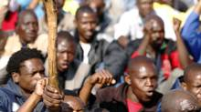 Striking miners react to a speech in Rustenburg Aug. 18, 2012. Youth joblessness in South Africa is estimated at about 50 per cent. (SIPHIWE SIBEKO/REUTERS)