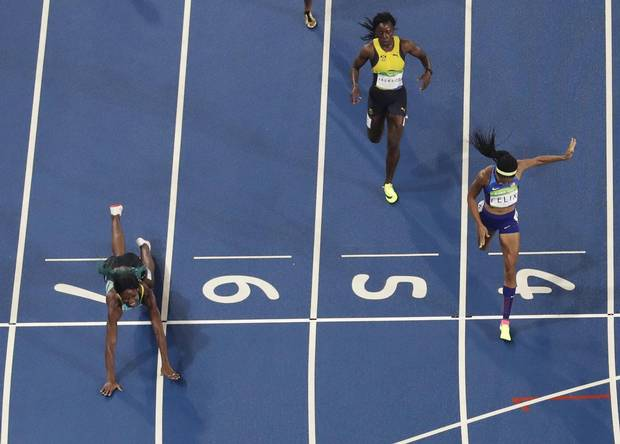 Bahamas' Shaunae Miller dives across the finish line ahead of United States' Allyson Felix to win the gold medal in the 400 meter finals during the athletics competitions of the 2016 Summer Olympics at the Olympic stadium in Rio de Janeiro, Brazil, Monday, Aug. 15, 2016.