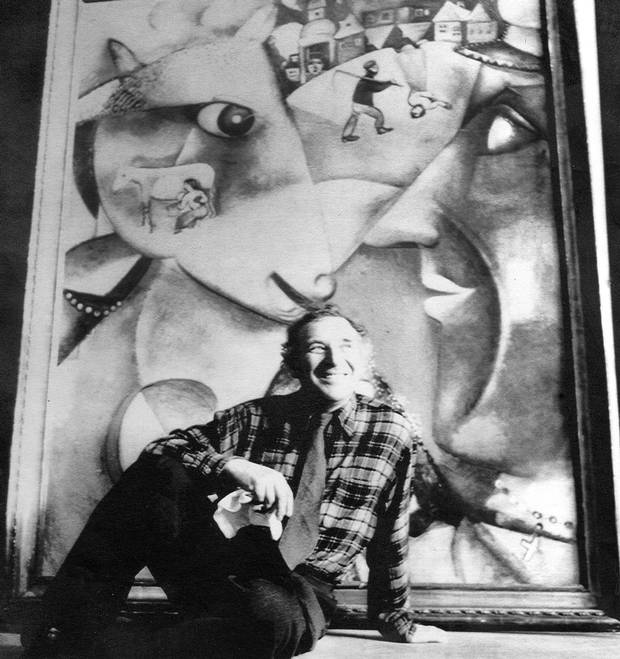 Marc Chagall in 1947 with his work, I and the Village.
