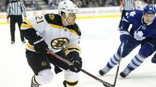 Boston Bruins defenseman Andrew Ference (21) controls the puck against the Toronto Maple Leafs at the Air Canada Centre. (Tom Szczerbowski/US PRESSWIRE/Tom Szczerbowski/US PRESSWIRE)