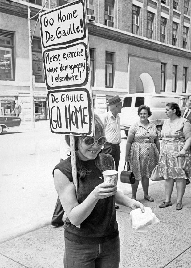 47e5a4b8329 July 25  A Toronto university student pickets outside the French consulate  on Bay Street. JOHN GILLIES THE GLOBE AND MAIL
