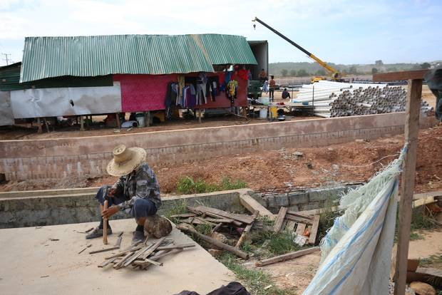 Construction workers build new factories in the 11-square kilometre Sihanoukville Special Economic Zone, one of China's most visible investments in Cambodia.