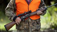 A rifle owner walks around his hunting camp in rural Ontario west of Ottawa on Sept. 15, 2010. (Sean Kilpatrick/THE CANADIAN PRESS)