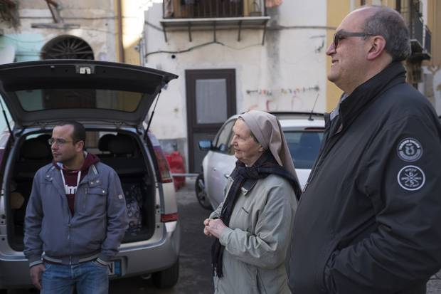 Sister Valeria, middle, and Father Vincenzo (Enzo) Volpe, right, estimate there are 500 Nigerians working against their will on Palermo's streets and in its brothels.