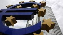 A euro logo stands in front of the headquarters of the European Central Bank in Frankfurt. (Ralph Orlowski/Reuters)