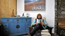 Shelagh Rogers reading in her home. (Charlie Cheffins)