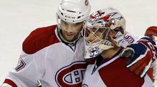 Montreal Canadiens left wing Benoit Pouliot (L) and goaltender Carey Price congratulate each other after beating the Boston Bruins in Game 2 of their NHL Eastern Conference quarter-final hockey game in Boston, Massachusetts April 16, 2011. REUTERS/Brian Snyder (Brian Snyder/Reuters)