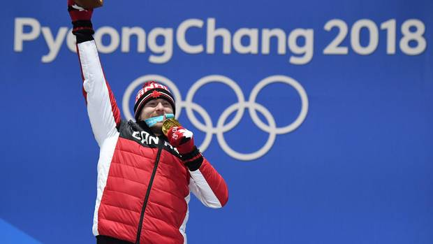 Canada's gold medallist Brady Leman poses on the podium during the medal ceremony for the freestyle skiing Men's Ski Cross at the Pyeongchang Medals Plaza during the Pyeongchang 2018 Winter Olympic Games in Pyeongchang on February 21, 2018.