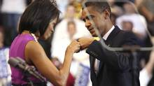 Barack Obama bumps fists with his wife, Michelle, before a speech in St. Paul, Minn., on June 3, 2008. (ERIC MILLER/REUTERS)