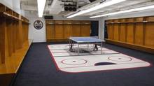 A ping pong table sits in the middle of the empty Edmonton Oilers' players dressing room at Rexall Place in Edmonton, Monday, Feb.7, 2004. (Walter Tychnowicz/CP)