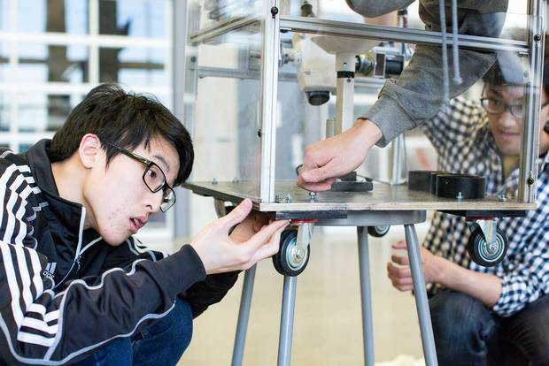 Landmine Boys, including Baruch Chao (left) and Ming Hu, picked up cash prizes for their landmine-defusing robot in two University of Waterloo-affiliated competitions in March.