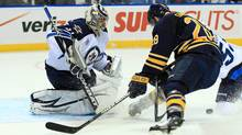 Winnipeg Jets goalie Ondrej Pavelec (31) stops a shot by Buffalo Sabres center Paul Gaustad (28) during the second period at the First Niagara Center. (Kevin Hoffman-US PRESSWIRE/US PRESSWIRE)