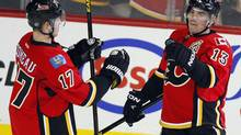 Calgary Flames' Mike Cammalleri, right, celebrates his goal with teammate Blake Comeau during second period NHL action in Calgary, Alta., Wednesday, March 27, 2013. (Jeff McIntosh/THE CANADIAN PRESS)
