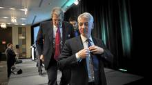 Bill Ackman, foreground, CEO of Pershing Square Capital Management, and Hunter Harrison, former CEO of Canadian National Railway, leave the stage after a town hall meeting Feb. 6, 2012, in Toronto. (Fred Lum/The Globe and Mail/Fred Lum/The Globe and Mail)