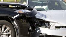 An SUV crashes into a sedan. (Thomas Eckstadt/iStockphoto)
