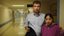 John Edwards and his wife Matilde are photographed at Hamilton general Hospital where her brother Edgar Puma is. He was critically injured in the van crash which killed 10 migrant workers. (Fred Lum/Fred Lum/The Globe and Mail)