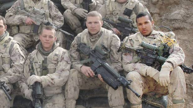 Lionel Desmond (front row, far right) was part of the 2nd battalion of the Royal Canadian Regiment, based at CFB Gagetown. Here, he is shown in 2007 in Afghanistan's Panjwai district, in between patrol base Wilson and Masum Ghar.