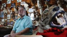 LaVerne Holmes sits among his work at his shop in Mill Bay, B.C. Mr. Holmes has been a professional taxidermist for over 25 years. (Chad Hipolito for The Globe and Mail)