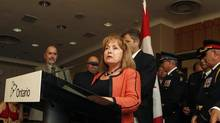 Madeleine Meilleur, Minister of Community Safety and Correctional Services, announces new measures about use-of-force options available to front-line police officers, at a press conference at the Coroners Court in downtown Toronto, August 27, 2013. (Fernando Morales/The Globe and Mail)