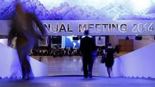 Participants take a break between sessions at the annual meeting of the World Economic Forum on Jan. 23, 2014. (Ruben Sprich/Reuters)