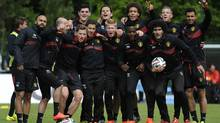 Belgium's soccer team pose for photographers during a training session at the squad's camp ahead of the World Cup, in Knokke-Heist June 5, 2014 (Reuters)