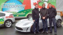 Kent Rathwell (left) and Christopher Misch (right) are crossing Canada in a Tesla Roadster. Bert Hickman, president of Hickman Chevrolet Cadillac in St. John's, joins them at the launch. (Sun Country Highway)
