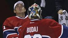 Montreal Canadiens goalie Carey Price (L) looks at the scoreboard as goalie Peter Budaj (30) skates to the bench during a break in play in third period NHL hockey action against the Florida Panthers in Montreal, October 24, 2011. (CHRISTINNE MUSCHI/REUTERS)