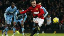 Manchester United's Wayne Rooney misses a penalty during a match against West Ham United Jan. 16, 2013. The club listed on the New York Stock Exchange last year. (PHIL NOBLE/REUTERS)