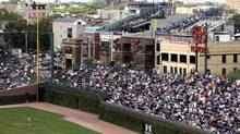 In this photo taken Sept. 3, 2010, many empty seats are seen on the bleachers on the rooftops of the buildings across from Wrigley Field outfield during a baseball game between New York Mets and Chicago Cubs Friday, Sept. 3, 2010 in Chicago. (Kiichiro Sato/The Associated Press)