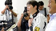 The Japan Professional Baseball Players Association Chairman Takahiro Arai speaks during a news conference in Nishinomiya, Japan, Tuesday, Sept. 4, 2012. (Associated Press)