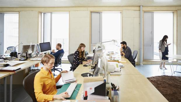 An example of what a modern work space looks like. Employees share desk space and private offices, conference rooms and private phone booths.