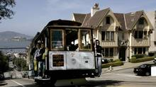 San Francisco's cable cars are a big draw, and not just for kids. (ROBERT GALBRAITH/REUTERS)