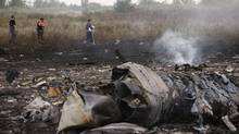 The Boeing 777, which was flying from Amsterdam to Kuala Lumpur, was shot down by a surface-to-air missile, U.S. officials said. The downing of the passenger jet dramatically raises the stakes and further drags the international community into eastern Ukraine's violent three-month-old rebellion. (Maxim Zmeyev/Reuters)